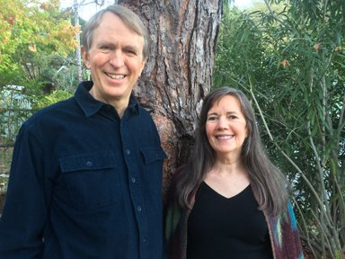 Alan Sheets and Siska Tovey New Equations cofounders standing at tree photo