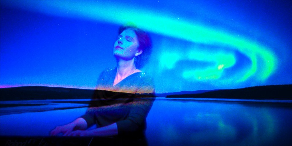 composer Siv Roland of New Equations Music playing keyboard under Aurora