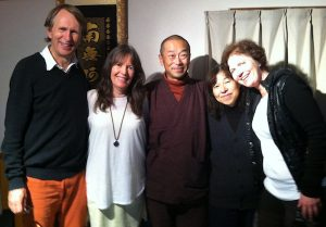 Alan Sheets, Siska Tovey, Showzen Yamashita and Siv Roland smiling in Japan