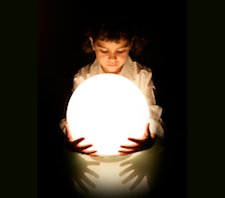 A boy holding a ball of white light