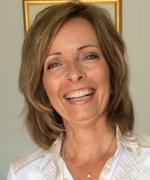 Hanne Kristin, a blonde woman smiling