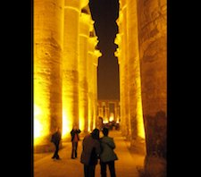 People standing in the Luxor Temple in Egypt surrounded by pillars