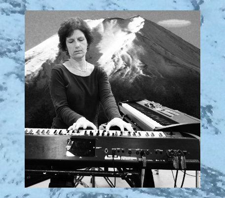 Siv Roland playing piano in front of a photo of Mt. Fuji
