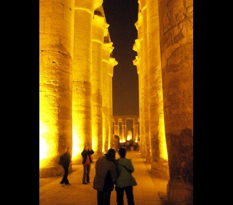People standing between pillars in the Luxor Temple - Cover Art
