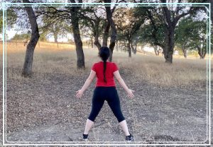 Woman doing Spiritual Posture in Nature