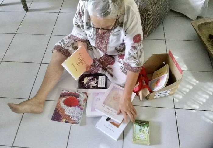 Betty examining her Parcel from Paradise