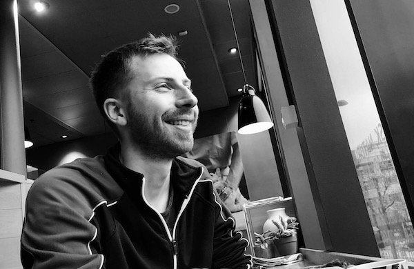Fabian smiling in a cafe