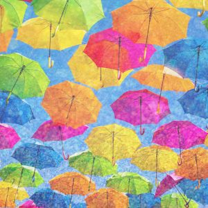Colorful umbrellas floating in the air