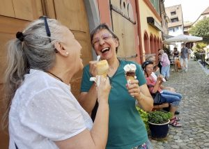 Betty and Maria laughing with ice cream